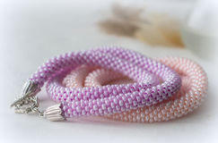 Two handmade necklaces from pink and lilac beads Royalty Free Stock Images