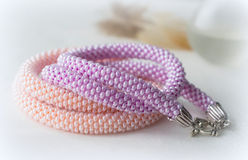 Two handmade necklaces from pink and lilac beads Royalty Free Stock Photo