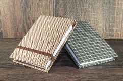 Two handmade notepads decorated with fabric used for writing reminders of your life or business. Stock Photos
