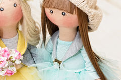 Two handmade rag dolls - blonde and brown-haired Royalty Free Stock Photo