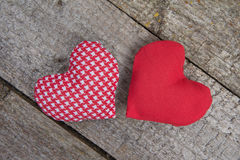 Two handmade red hearts on rustic wooden background Royalty Free Stock Image