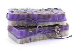 Two handmade soaps with wildflowers on white background. Horizontal stock photo