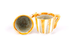Two handmade varnished cups. Royalty Free Stock Photo