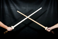Two handmade wooden swords Royalty Free Stock Photos
