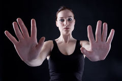 Two hands. Attractive caucasian girl showing two hands. Image isolated on black background Stock Image