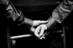 Two hands. Two man's hands. The black-and-white Royalty Free Stock Photos