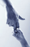 Two hands. Child hand holding adult hand Royalty Free Stock Photo