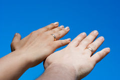 Two hands. Against the blue sky Royalty Free Stock Image