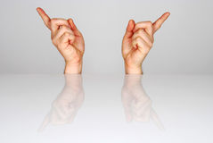 Two hands. Fingers pointing in the opposite direction royalty free stock photos
