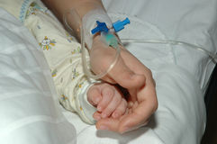 Two hands. Mothers and babies, with infusion pipes Royalty Free Stock Photos