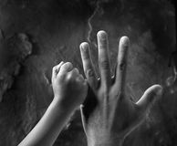 Two hands. Father and son love Stock Images