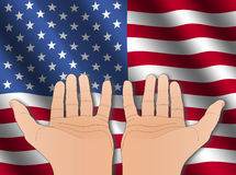 Two hands with American flag Stock Photos