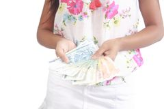 two hands of asian girl holding heaps of pesos Royalty Free Stock Photography