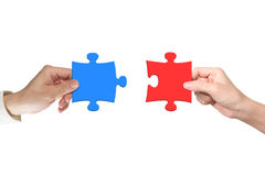 Two hands assembling jigsaw puzzle pieces Royalty Free Stock Photography