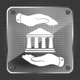 Two hands with badge with bank icon. On a mettalic background - vector illustration Stock Photo