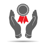 two hands with badge and red ribbons icon Royalty Free Stock Photography