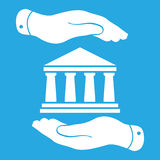 Two hands with badge with white bank icon on a blue background -. Vector illustration Royalty Free Stock Photography