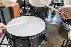 Two hands beat into a drum. Two hands drumsticks beating on a drum, first-person view royalty free stock photos