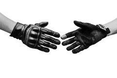 Two hands biker meet in hand shake Stock Image