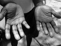 Two hands of a black man islander. Black white Royalty Free Stock Image