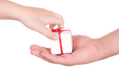 Two hands and box with  gift. On  white background Royalty Free Stock Photo