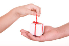 Two hands and box with  gift. On  white background Royalty Free Stock Photography