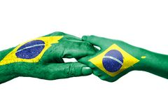Two hands and Brazilian flag Royalty Free Stock Image