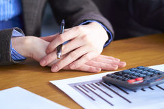 Two hands with calculator and some paperwork Royalty Free Stock Photo