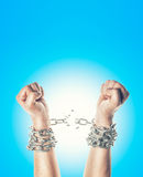 Two hands in chains. On a white background stock photos