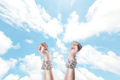 Two hands in chains. On a white background royalty free stock photo