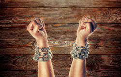 Two hands in chains Royalty Free Stock Photography