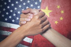Two hands with China and United States flag. Concept of peace. two hands people posing partnership with China and United States flag in the background royalty free stock photos