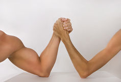 Two hands clasped arm wrestling (strong and weak), Unequal match royalty free stock photo