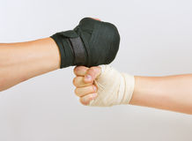 Two hands clasped arm wrestling, the struggle of black and white. Hand in a white glove and hand in a black glove clasped arm wrestling, good and evil opposition Royalty Free Stock Photography