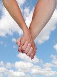 Two hands clasped in love Royalty Free Stock Photos