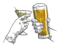 Two hands clink a glass of beer and cocktails. Royalty Free Stock Photography