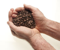 Two hands with coffee Royalty Free Stock Photos