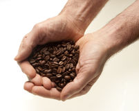 Two hands with coffee Stock Images