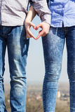 Two hands coming together to create a heart stock images