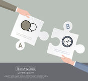Two hands connecting puzzle pieces Royalty Free Stock Photography