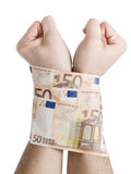 Two hands cuffed bills 50 euros Royalty Free Stock Photography