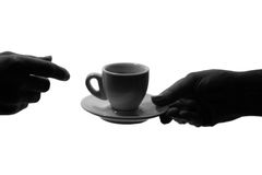 Two hands and a cup of hot drink. Black white Stock Photography