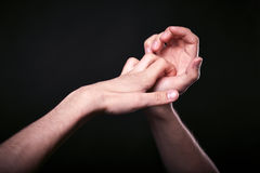 Two hands in the dark. Beautiful man`s hands on black background close up Royalty Free Stock Photo
