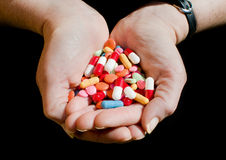 Two hands with drugs and pills Stock Photo