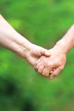 Two hands  of the elderly couple Royalty Free Stock Image