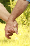 Two hands of an elderly couple Royalty Free Stock Images