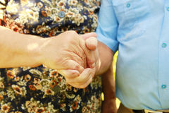 Two hands of an elderly couple Royalty Free Stock Photos