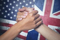 Two hands with England and United States flag Stock Images