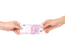 Two hands and 500 euro banknote. Stock Photo