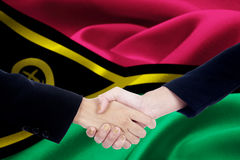 Two hands with flag of Vanuatu Stock Image